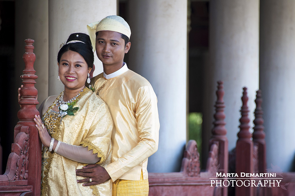 Wedding couple in traditional dresses, posing at the Royal Place, Mandalay, Myanmar